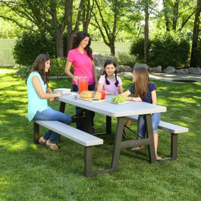 Lifetime 6-Foot Picnic Table - Built with the traditional W-frame design, the 72 in. x 30 in. high-density polyethylene tabletop is stain resistant, easy to clean and folds flat for storage. This model comes in putty with a bronze folding frame and includes an umbrella hole and cap. 2-year limited warranty. photo