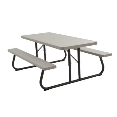 Lifetime 6-Foot Picnic Table - The 72 in. x 30 in. high-density polyethylene tabletop is stain resistant, easy to clean and folds flat for storage. This model comes in putty with a bronze, 1-5/8 in. round folding frame and includes an umbrella hole and cap. Single box packaging. 2-year limited warranty. photo