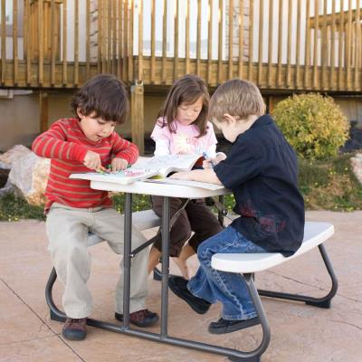 Lifetime Children's Picnic Table - The 32.5 in. x 19 in. high density polyethylene (HDPE) tabletop is stain resistant, easy to clean, and folds flat for storage. This model comes in almond with a bronze folding frame. 2-year limited warranty. photo