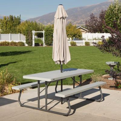 The Lifetime 6-Foot Picnic Table gives you that perfect extra outdoor eating space you've always wanted. Constructed of UV-protected high-density polyethylene and powder-coated steel, our picnic tables are weather and rust resistant, and will not fade, crack, chip or peel. Stronger and more durable than wood, they are low-maintenance, stain resistant and easy to clean. Best of all, Lifetime picnic tables fold completely flat for convenient storage.   photo