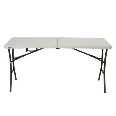 Lifetime 5-Foot Essential Fold-In-Half Tables are constructed of high-density polyethylene and have a convenient folding design for easy transport and storage. The lightweight design and convenient carry handle make it easy for anyone to set up and take down. Our tables are UV-protected, will not crack, chip or peel, and are built for indoor and outdoor use. The patented steel frame design provides a sturdy foundation and is protected with a powder-coated, weather-resistant finish. Ideal for family game night, outdoor activities and more, Lifetime's Fold-In-Half Tables are the perfect addition to your home. photo
