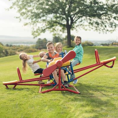 Fuel your child's inner-pilot with the Lifetime Ace Flyer Teeter-Totter. Ride on the wings for an up-and-down action, or in the cockpit for a side-to-side movement. The Ace Flyer Teeter-Totter will set their imaginations soaring as they work the controls on the dashboard, spin the propeller, and steer their plane through the big blue sky. photo